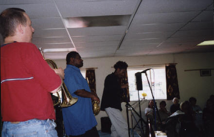 Andy Hague (trumpet), Pee Wee Ellis (tenor sax), and Ripton Lindsay (poet)