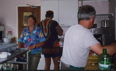 Linda (left), Linda's partner Rob (centre), and Jon (right) in the kitchen